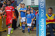 Ian Henderson leads the team and mascots out during the EFL Sky Bet League 1 match between Rochdale and Gillingham at Spotland, Rochdale, England on 23 September 2017. Photo by Daniel Youngs.