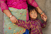 A member of the Shree Khanideri Sanokishan Krishi Sanakari Women's Co-operative and a young girl, Kakani, Nuwakot District, Nepal