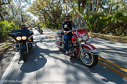 Danilo Dibierro of Italy out for a ride with Melissa Shoemaker on Danilo's rented Harley-Davidson dresser alongside Warren Lane on his stock 1964 Panhead during Daytona Bike Week. FL, USA. March 14, 2014.  Photography ©2014 Michael Lichter.