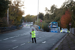 © Licensed to London News Pictures. 27/10/2019. Salford, UK. Police conduct a survey of the scene . A car lies on its side on a pedestrian walkway at the Pendleton Roundabout on Broad Street in Salford . Members of the public pulled a man and a woman from the wreckage after a BMW car crashed through a barrier and landed on a pedestrian walkway below . Their condition is unknown and police , paramedics and fire crews are at the scene . Photo credit: Joel Goodman/LNP