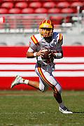 Oakdale quarterback Adam Olsen (10) carries the ball against Manteca during Friday Night Lights at Levi's Stadium in Santa Clara, California, on October 11, 2014. Oakdale beat Manteca 42-21. (Stan Olszewski/ Special to The Record)