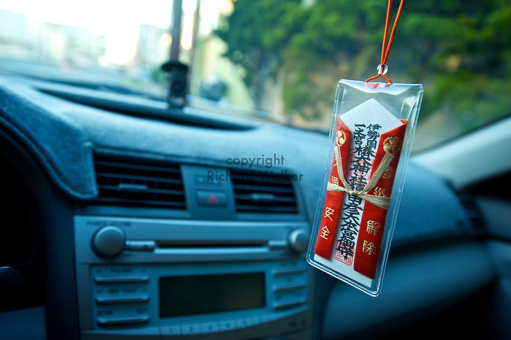 2011 January 03 - Traffic safety omamori talisman from Tsubaki Grand Shrine hangs in a Toyota Camry. CREDIT: Richard Walker