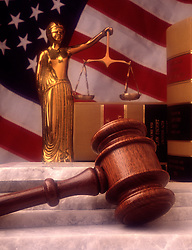 Brass statue blind justice with scales judges court gavel law books reference granite stone steps US USA American flag law legal system CONCEPT STOCK PHOTOS
