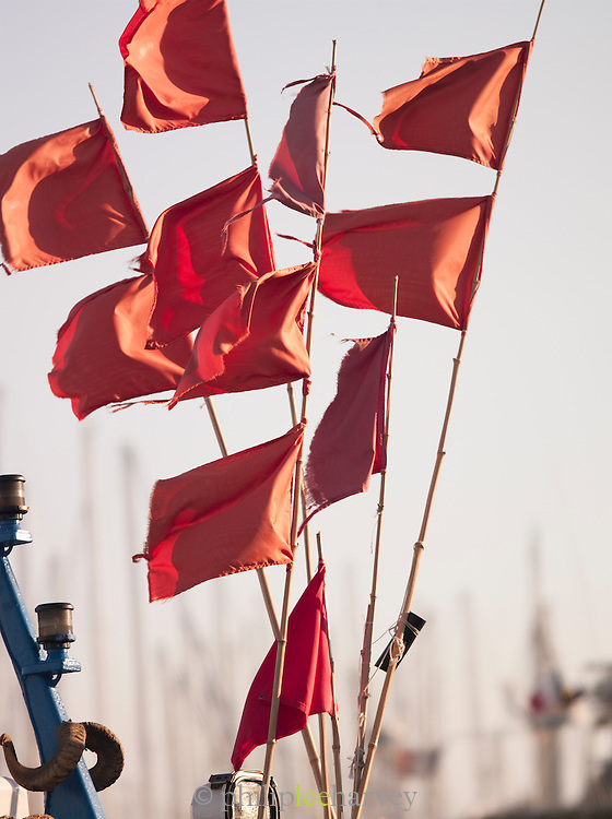 Flags on a ship in the harbour at Bandol, France