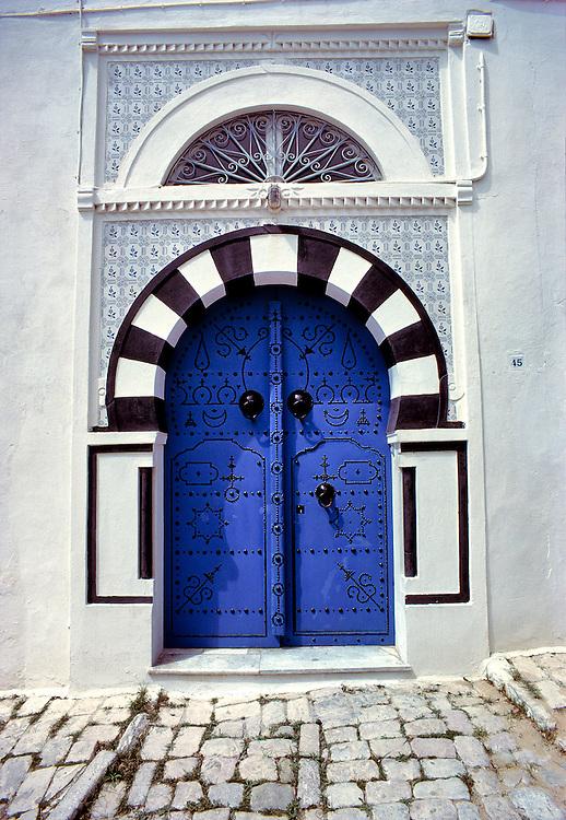 Tiles decorate a sapphire blue door in Sidi Bou Said, Tunisia.