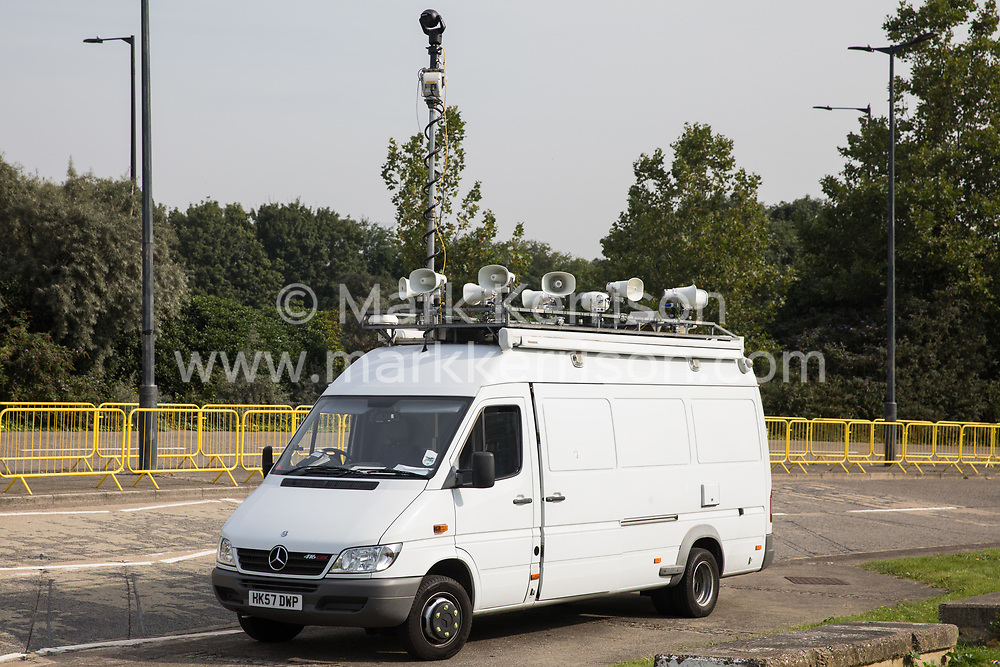 London, UK. 6th September, 2021. A tannoy and surveillance vehicle used in conjunction with the Metropolitan Police is pictured outside ExCeL London as preparations take place for the DSEI 2021 arms fair. The first day of week-long Stop The Arms Fair protests outside the venue for one of the world's largest arms fairs was hosted by activists calling for a ban on UK arms exports to Israel.