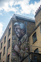 July 21, 2017 - London, United Kingdom - A giant portrait of Nelson Mandela is seen on a wall of Camden, London, on July 21, 2017. The mural has been made to mark 99 years since Nelson Mandela was born. Since 2009, the former South African President and Nobel Peace Prize winner's birthday has been celebrated as Mandela Day – a reminder of his work and message. (Credit Image: © Alberto Pezzali/NurPhoto via ZUMA Press)