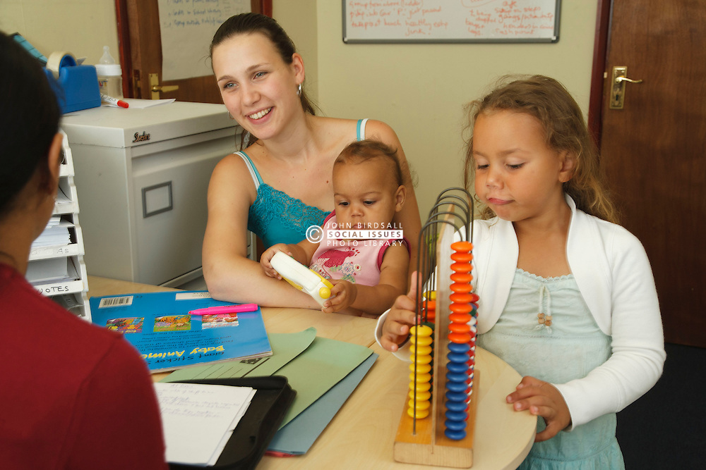Young mother with children in Social worker's office.