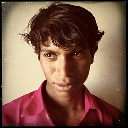 "iPhone portrait of Dinesh Chandra Ninama, 14, in a village outside of Banswara, Rajasthan, India, May 21, 2013. ""This is what happens when you get married young, 'Oh dear, go here, go there!' I would go for laboring then I'd start boozing. In my village there are people who got married and do this,"" said Ninama. <br /> <br /> Under Indian law, children younger than 18 cannot marry. Yet in a number of India's states, at least half of all girls are married before they turn 18, according to statistics gathered in 2012 by the United Nations Population Fund (UNFPA). However, young girls in the Indian state of Rajasthan—and even a few boys—are getting some help in combatting child marriage. In villages throughout Tonk, Jaipur and Banswara districts, the Center for Unfolding Learning Potential, or CULP, uses its Pehchan Project to reach out to girls, generally between the ages of 9 and 14, who either left school early or never went at all. The education and confidence-building CULP offers have empowered youngsters to refuse forced marriages in favor of continuing their studies, and the nongovernmental organization has provided them with resources and advocates in their fight."
