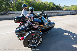 Skyler Keim-Jones, a Florida MDA goodwill ambassador, gets a ride in a Harley sidear model during Annual MDA Ladies Run to Destination Daytona sponsored by Harley-Davidson every year on the Tuesday of Daytona Beach Bike Week. FL, USA. March 10, 2015.  Photography ©2015 Michael Lichter.