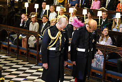 Prince Harry (right), accompanied by his best man the Duke of Cambridge, arrives in St George's Chapel at Windsor Castle ahead of his wedding to Meghan markle wedding.
