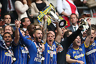 Captain Barry Fuller lifting the play off final trophy alongside Callum Kennedy following a 2-0 win in the Sky Bet League 2 play off final match between AFC Wimbledon and Plymouth Argyle at Wembley Stadium, London, England on 30 May 2016.