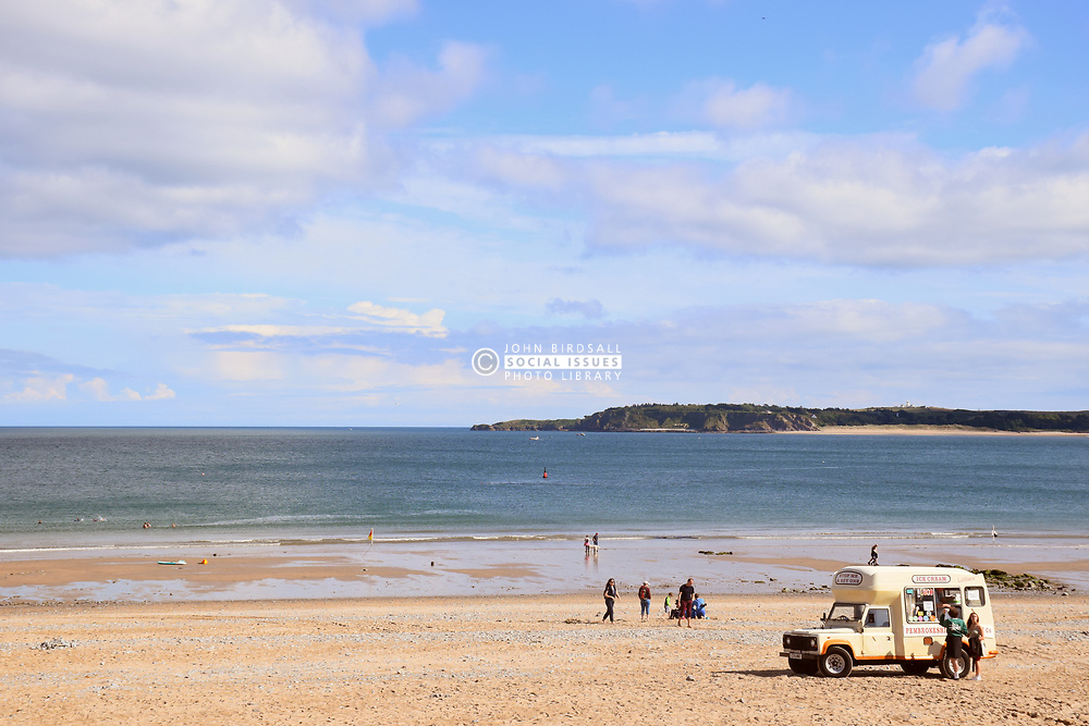 Ice cream van, South Beach, Tenby, Pembrokeshire South Wales July 2021. Caldey Island in the distance