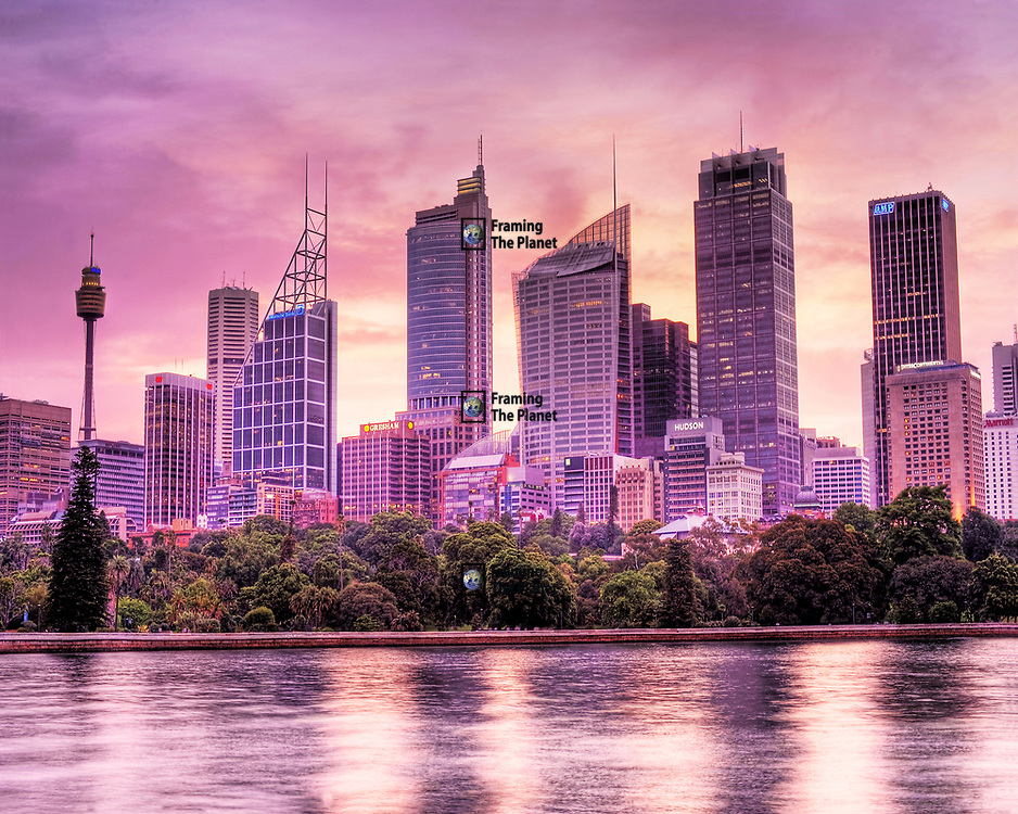 This is one of my favourite shots from my trip down under and yet it might never have existed. I was intending to photograph the harbour but when I turned round I was great by this amazing sight. The summer sun was setting and the sky had turned this rich pink and purple so full of character and life that I had to abandon photographing the harbour and focus on this fantastic image.<br /> <br /> This view is often missed in photography, we have the famous Sydney Tower with its high observation deck to the left across to the towers that make up the main business area of the city. This image was taken from the edge of Sydney harbour at the end or the botanical gardens as the sun set on an amazing summers day.<br /> <br /> The harbour bridge and opera house which are more normally photographed would be just off to the right but I think it was well worth pointing the camera in the opposite direction to grab this great shot. <br /> <br /> This image is ready to download for personal or commercial use and to order as a limited edition print. I will only make available 50 prints of this image, you can choose to have it printed on canvas or as a framed or unframed print ensuring you have an exclusive peace of highly collectable photo art to add to any home or business.