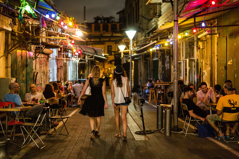 People are seen hanging out at bars and restaurants at Shuk Hapishpeshim (Flea Market) in Jaffa