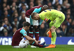 West Ham United goalkeeper Joe Hart (right) and Angelo Ogbonna (centre) check on team-mate Aaron Cresswell after he picks up an injury