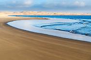 Lac Naila - Sahara desert sand dunes at the Atlantic coast, Morocco.