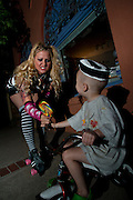 Cellblock 9 rollergirl takes candy from a baby