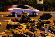 People settling down for the night in New Preston Road, Lancashire, United Kingdom, June 29th 2018.  Block Around the Clock - a fourty eight hours of event with work shops, yoga, sleeping and anti-fracking campaigning in front of the gates to Cuadrillas fracking site in Lancashire. The event was organised by anti-fracking campaigners in spite of an injunction granted to Cuadrilla to prevent protest against the impending shale gas exploitation. The Cuadrilla site in Lancashire in a highly contested site, almost ready to drill for gas.
