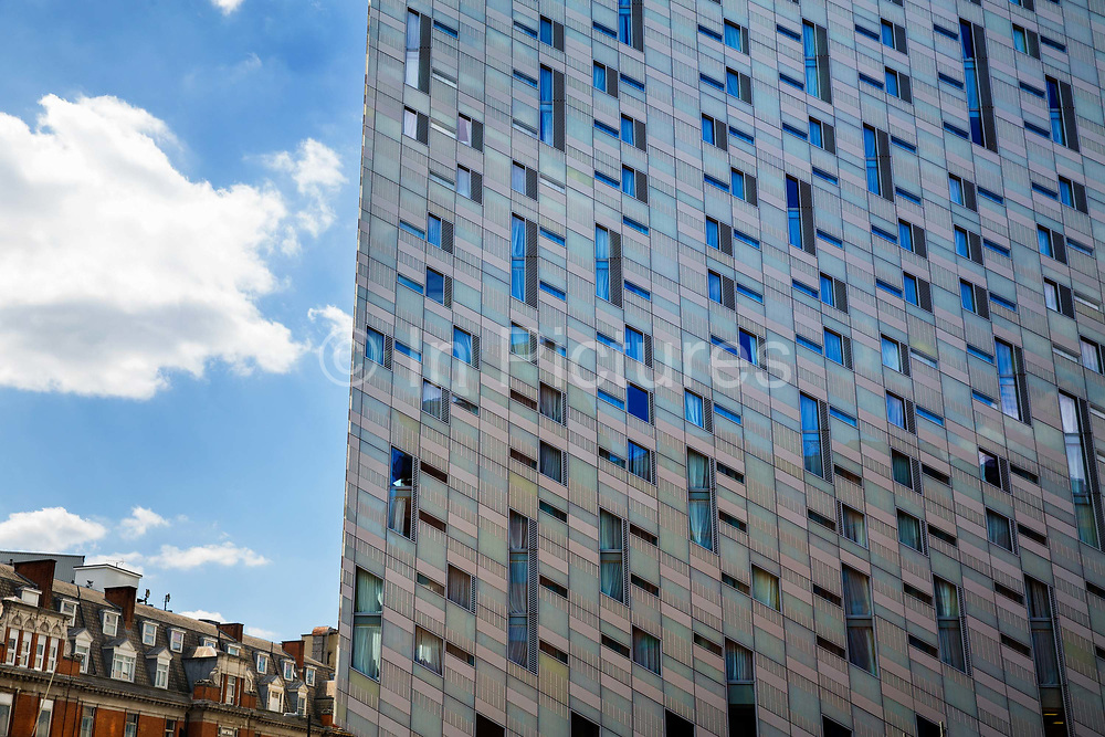M by Montcalm is a 23-storey boutique hotel, built in 2015 near Old Streets Silicon Roundabout in Shoreditch, United Kingdom. The buildings signature is that its whole exterior, including cladding and windows, is sloped at an angle to give false perpectives.