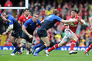 Alex Cuthbert of Wales ® breaks away from Aurelien Rougerie (13), RBS Six nations champs 2012, Wales v France at the Millennium Stadium in Cardiff, South Wales on Saturday 17th March 2012.  pic by Andrew Orchard, Andrew Orchard sports photography,