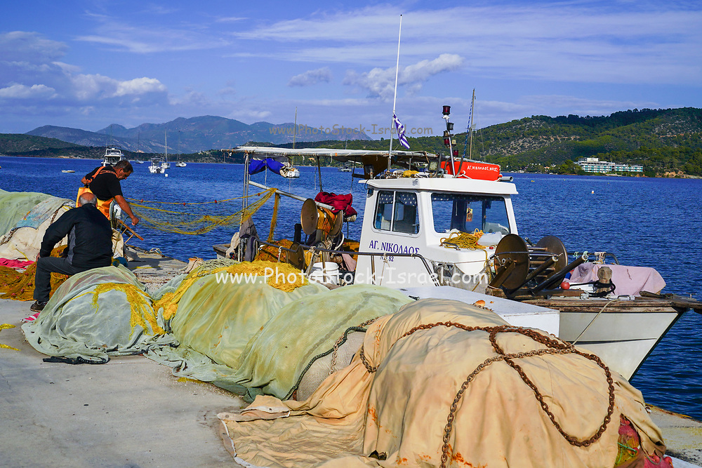 Fishermen and fishing boats on Poros Island, Greece. Poros is a small Greek island-pair in the southern part of the Saronic Gulf, Greece