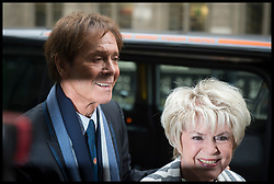April 13, 2018 - London, London, United Kingdom - Sir Cliff Richard and Gloria Hunniford arrive at the Rolls Building, High Court, UK...Sir Cliff Richard arrives at The High Court in London, UK, where he is suing the BBC after they broadcast footage of police searching his home in connection with allegations of a historic sexual offence. (Credit Image: © Ben Stevens/i-Images via ZUMA Press)