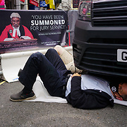A few activists protest for the climate change lock themselves under a van at St Martin lane on 2021-08-23, London, UK.