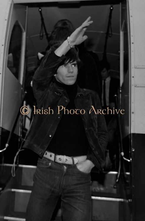 .Historic Irish Photographs To Feature in New Rolling Stones DVD Release..Fourteen never before seen photographs of The Rolling Stones, which were shot in Dublin in 1965, are to feature prominently in a new DVD and Blu-Ray, which is being released on November 2...The Rolling Stones Charlie is My Darling - Ireland 1965 film has its world premiere in New York on Saturday, September 29, and will then receive an international release. (see details below).Picture Caption.The Rolling Stones Charlie is my Darling - Ireland 1965.Brian Jones and Keith Richards of The Rolling Stones exiting the airport bus at Dublin Airport before thier concert at the Adelphi Theatre. This was the band's second Irish tour of 1965. ..The DVD of the film will be released on November 2 and the film box set and 42-page Collector's Edition hardcover book includes 14 never before seen images that have been painstakingly restored by the Irish Photo Archive. The original images were shot by Lensmen Photographic Agency, which was established in 1952 and is still a prominent Dublin-based photography company..The images were taken on September 3 1965, when the movie was shot on a quick weekend tour of Ireland just weeks after ?(I Can't Get No) Satisfaction? hit No. 1 on the charts and became the international anthem for an entire generation. The images feature the band at Dublin Airport, performing at the Adelphi, backstage and at Connolly Station. The Rolling Stones photographs will be on public display in the mezzanine area of Terminal 1 at Dublin Airport from November..The Stones photos, were recently discovered when the Irish Photo Archive was being catalogued. The archive is a treasure trove of more than two million photos, including many other celebrity photos that have never been published..The Rolling Stones images are online at www.irishphotoarchive.ie Please credit www.irishphotoarchive.ie published any of our images and link to our web site, Many thanks...For further information contact:.Offi