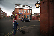Storm clouds build over old red brick industrial buildings at the Anchor Inn Pub in Digbeth, Birmingham, England, United Kingdom. Digbeth is an area of Central Birmingham, England. Following the destruction of the Inner Ring Road, Digbeth is now considered a district within Birmingham City Centre. As part of the Big City Plan, Digbeth is undergoing a large redevelopment scheme that will regenerate the old industrial buildings into apartments, retail premises, offices and arts facilities. There is still however much industrial activity in the south of the area.