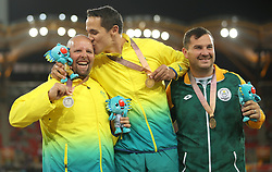 Gold medallist in the Men's F38 Shot Put Final Australia's Cemeron Crombie (centre) with silver medallist Australia's Marty Jackson (left) and bronze medallist South Africa's Reinhardt Hamman at the Carrara Stadium during day seven of the 2018 Commonwealth Games in the Gold Coast, Australia. PRESS ASSOCIATION Photo. Picture date: Wednesday April 11, 2018. See PA story COMMONWEALTH Athletics. Photo credit should read: Danny Lawson/PA Wire. RESTRICTIONS: Editorial use only. No commercial use. No video emulation.