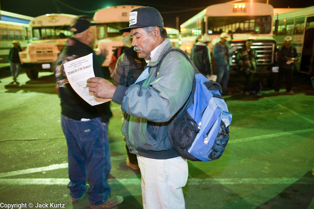 28 NOVEMBER 2006 - SAN LUIS, AZ: A farm worker reads his labor contract after entering the US at the Port of Entry in San Luis, AZ, about 20 miles south of Yuma. Farmers and agricultural producers around Yuma, AZ, are facing a growing shortage of farm workers. Increased border enforcement have deterred many illegal workers from seeking work in Arizona and long lines at the ports of entry for legal workers are leading to the labor shortage. Some labor contractors are reporting as much as a 40 percent shortage of farm workers, Yuma farmers planted 15 percent fewer acres this year, compared to last, because of the shortage. More than 100,000 acres of iceberg lettuce are cultivated in Yuma county and more than 50,000 people are employed as seasonal farm workers at the height of the harvest, which is December through February. Nearly 3,500 seasonal farm workers stand in line for up to two hours every morning at the San Luis, AZ, Port of Entry to enter the US legally to work in the fields. Experienced workers can make as much as $14 (US) per hour during the harvest.  Photo by Jack Kurtz/ZUMA Press