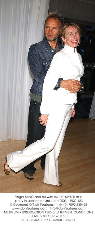 Singer STING and his wife TRUDIE STYLER at a party in London on 3rd June 2003.PKC 123