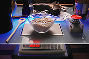The Counter Intelligence program at MIT Media Lab in Boston, Massachusetts is focusing on developing a digitally connected kitchen of the future. By exploring new technologies they hope to expand the art of food preparation as well as social interactions in the kitchen. One aspect of their research is to create kitchen utensils that contain memories. In this image a digital scale helps to measure out meals.  Scale built into countertop. While the project is ongoing, these images were shot in 1999. (1999)
