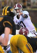 Alabama Crimson Tide quarterback AJ McCarron (10) calls signals late in the first half. The Alabama Crimson Tide defeated the Missouri Tigers 42-10 at Memorial Stadium in Columbia, Missouri on October 13, 2012.