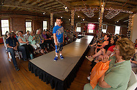 1Adam Hough commands the runway dressed in Nike during the Fashion and Flair event at the Belknap Mill Sunday afternoon.  (Karen Bobotas/for the Laconia Daily Sun)