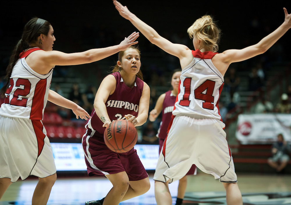 Shiprock's Summer Tallbull passes the ball between Portales defenders Gabby Garcia and Emily Roberts during the second half. Shiprock defeated Portales 35-33 in the AAA semifinals Thursday morning in Albuquerque at The Pit.
