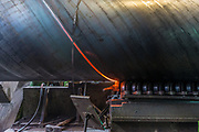 Pipe manufacturing plant. Large diameter Metal pipes factory welding the rolled metal