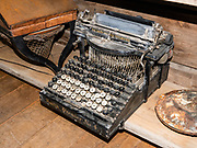 The Smith Premier No. 4 typewriter, 1890s-1940. San Juan County Historical Society Museum, Silverton, Colorado, USA. Silverton is a former silver mining camp, now the federally-designated Silverton Historic District. Durango is linked to Silverton by the Durango and Silverton Narrow Gauge Railroad, a National Historic Landmark. Silverton no longer has active mining, but subsists on tourism, maintenance of US 550 (which links Montrose with Durango), mine pollution remediation, and retirees.