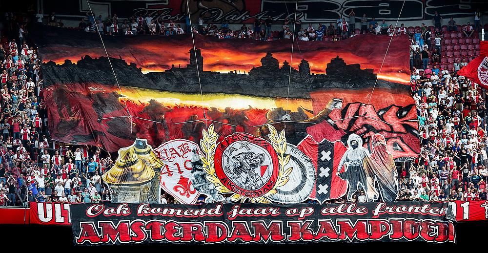 Nederland. Amsterdam, 12-08-2012. Foto: Patrick Post.  Ajax-Az. Eindstand: 2-2.  Supporters van vak 410 hebben een spandoek uitgerold dat verwijst naar het kampioenschap van afgelopen seizoen.