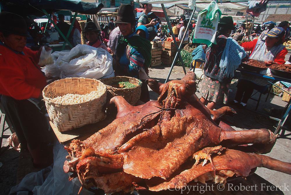 ECUADOR, MARKETS, CRAFTS Saquisili vendor selling pork chicharron