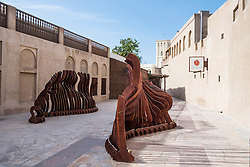 Outdoor sculpture in Bastakiya historic district in Al Fahidi Dubai United Arab Emirates