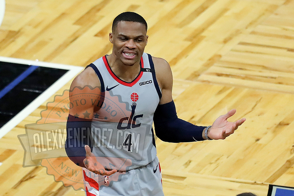 ORLANDO, FL - APRIL 07: Russell Westbrook #4 of the Washington Wizards argues a call against the Orlando Magic at Amway Center on April 7, 2021 in Orlando, Florida. NOTE TO USER: User expressly acknowledges and agrees that, by downloading and or using this photograph, User is consenting to the terms and conditions of the Getty Images License Agreement. (Photo by Alex Menendez/Getty Images)*** Local Caption *** Russell Westbrook