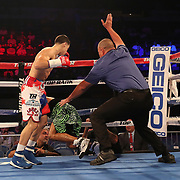NEW ORLEANS, LA - JULY 14:  Jean Carlos Rivera (L) knocks out Angel Luna during the Regis Prograis v Juan Jose Velasco ESPN boxing match at the UNO Lakefront Arena on July 14, 2018 in New Orleans, Louisiana.  (Photo by Alex Menendez/Getty Images) *** Local Caption *** Jean Carlos Rivera; Angel Luna