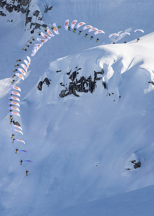 Andy Farington jumps off a large cliff into a spiraling barrel roll while filming for the Unrideables in the Tordrillo Mountains near Anchorage, Alaska on April 22rd, 2014.