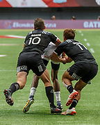 VANCOUVER, BC - MARCH 11: Perry Baker (#11) of USA brought down by Kurt Baker (#10) and Joe Webber (#11) of New Zealand during Game # 31- New Zealand vs United States Cup QF3 match at the Canada Sevens held March 10-11, 2018 in BC Place Stadium in Vancouver, BC. (Photo by Allan Hamilton/Icon Sportswire)