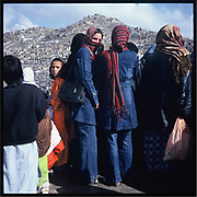 Young women in blue jeans gather on Nowruz, the Persian New Year, in Kabul.