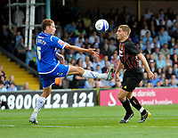 Stockport County's Jimmy McNulty (L) challenges Manchester City's Ched Evans for the ball<br />