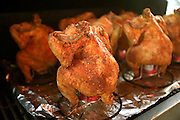 Bounty Hunter Restaurant and Bar, Napa, California. Napa Valley. Beer can chicken: whole chickens smoked on a grill over a beer can half full of beer for several hours.