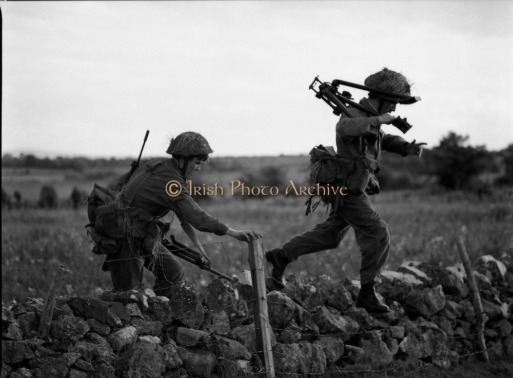 """Army Exercises In Co Sligo.   (L37).<br /> 1977.<br /> 05.09.1977.<br /> 09.05.1977.<br /> 5th September 1977.<br /> The Army Reserve Brigade, which is made up of regular units from the Southern Command, are conducting a series of conventional military exercises in counties Mayo and Sligo from the 5th to the 9th September. Approximately 1,500 men and 250 vehicles are involved. The exercise was codenamed """"Humbert"""" after an ill fated expedition by French troops into Ireland on 23rd August 1798. 1,100 French troops with Irish support took on the incumbent English forces. After some initial success they were defeated at Ballinamuk on 8th Sept 1798 by the army of Cornwallis.<br /> <br /> Picture shows some soldiers advancing to take up position during the military exercises."""